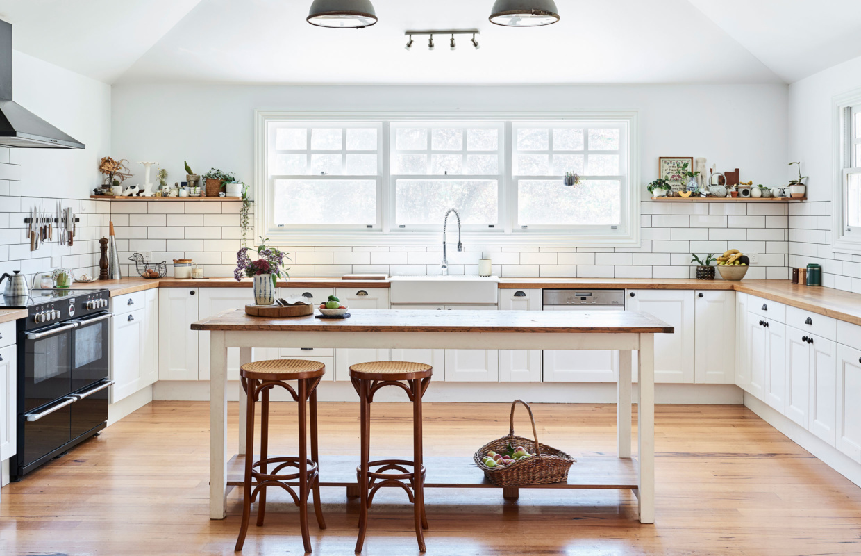 Elizabeths farmhouse kitchen picture perfect with fresh homegrown apples in the basket cabinetry details and island table by aaron pitt and stools from